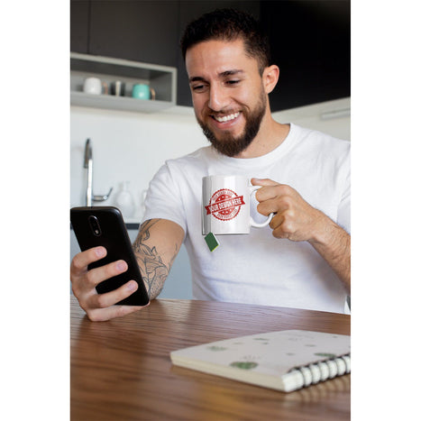 Guy drinking out of a personalized 11oz white ceramic mug