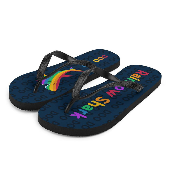 angel view of blue flip flops with rainbow text saying rainbow shark and image of rainbow shark
