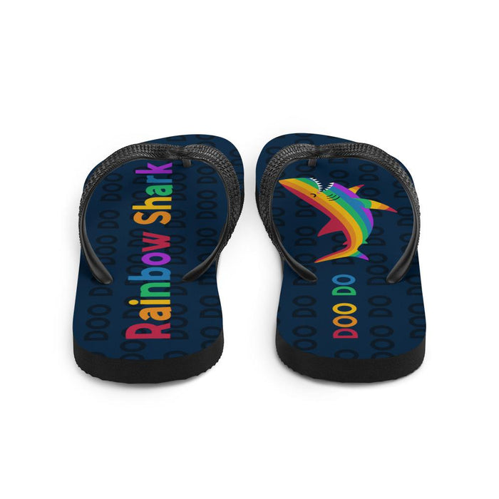 back view of blue flip flops with rainbow text saying rainbow shark and image of rainbow shark