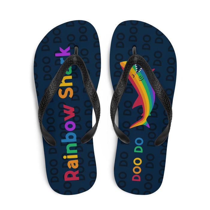 top view of blue flip flops with rainbow text saying rainbow shark and image of rainbow shark