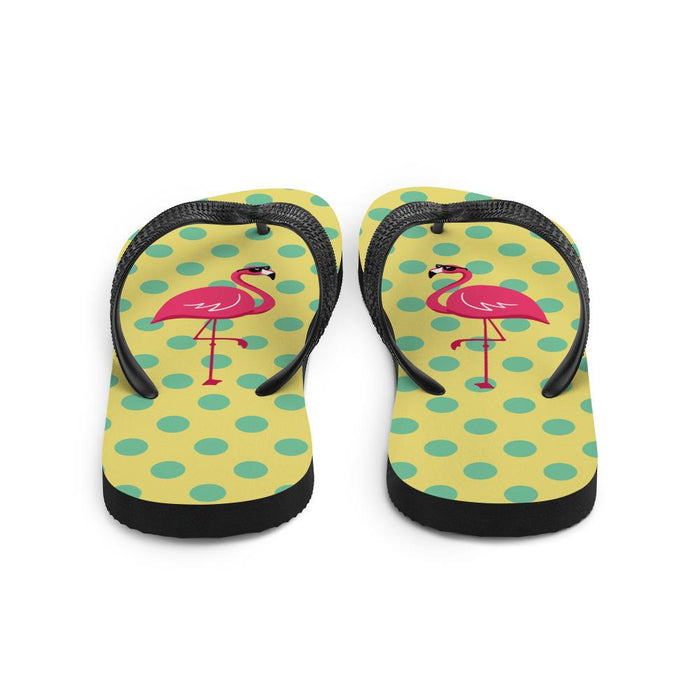 back view of yellow flips flows with green dots and image of flamingo
