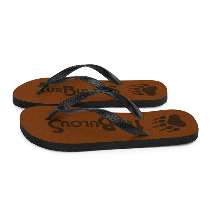 side view of brown flip flops with brown text furbulous and image of bear paw
