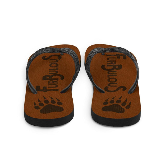 back view of brown flip flops with brown text furbulous and image of bear paw