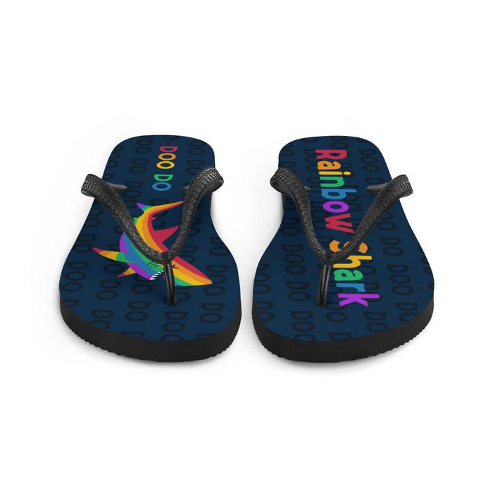 front view of blue flip flops with rainbow text saying rainbow shark and image of rainbow shark