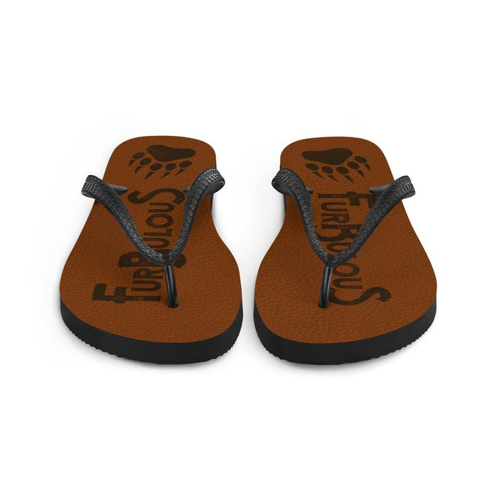 front view of brown flip flops with brown text furbulous and image of bear paw