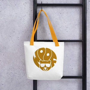 White 15 x 15 weather resistant fabric tote bag with gold straps and gold brown bear with woof text