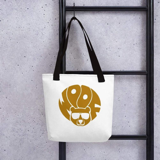 White 15 x 15 weather resistant fabric tote bag with black straps and gold brown bear with woof text