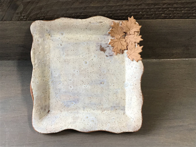 White square plate with leaves