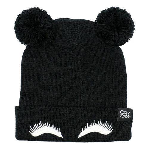 A black fashion beanie with two pom-poms on top with white eyelashes in front