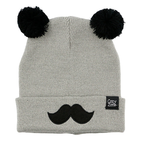 A grey fashion beanie with two pom-poms on top with black mustache in front