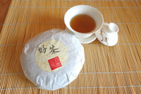 Wushe Qing Xin Oolong Tea cake - 2013 Vintage - Evergreen Teashop