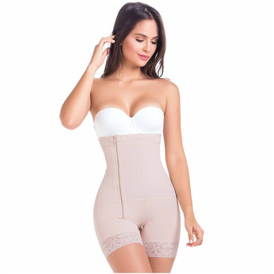 Our tummy control shapewear features mid-thigh length that gopes unnoticed under clothing. Backless and strapless, perfect for wearing under a dress. Ideal as daily shapewear. Made of Powernet, a smart blend of polyamide and elastane. Its cotton lining protects skin from irritation. Silicone laces that keep the girdle from rolling up. Zippered crotch for added comfort when going to the restroom. High Compression Open bust Removable straps Side zipper. Sizes: From XS to 3XL