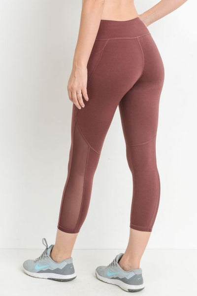 Mesh Overlay Pocket Capri Leggings Deep Plum & Moon Rust This pair of supersleek leggings feature zipperless side pockets, mesh panels that run from mid-thigh down to the bottom leg opening, and strategically-placed seams for a dynamic look.  Colors: Deep Plum and Moon Rust  88% polyester, 12% spandex. Moisture wicking. Four-way stretch.