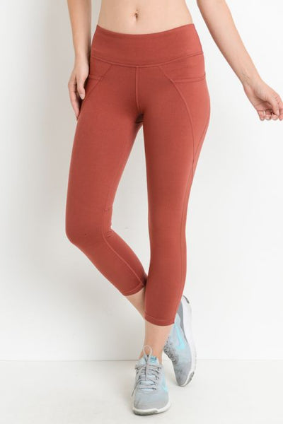 Mesh Overlay Pocket Capri Leggings Moon Rust This pair of supersleek leggings feature zipperless side pockets, mesh panels that run from mid-thigh down to the bottom leg opening, and strategically-placed seams for a dynamic look.  Color: Moon Rust  88% polyester, 12% spandex. Moisture wicking. Four-way stretch. Made in China.
