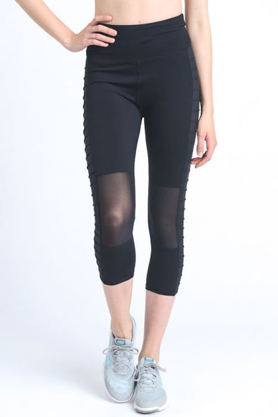 Highwaist Side Ribbed Moto Capri Leggings  These sleek capri leggings are just perfect for a stylish summer outing. They feature a zippered back pocket for your small essentials and ribbed moto panel accents on the outer thigh.  88% polyamide, 12% elastane. Moisture wicking.