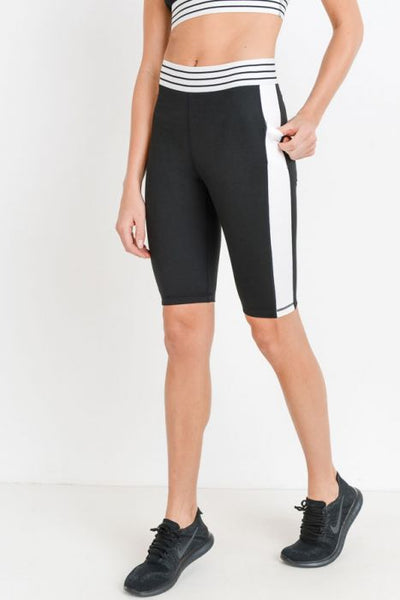 Highwaist Colorblock Striped Band Active Shorts  Be a black-and-white delight in these active shorts! With its flattering white side panels, back pocket with white details, side pockets (perfet size for your phone), and striped elasticized waist band, these shorts are the perfect alternative to leggings.