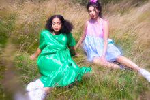 Load image into Gallery viewer, Shannon, sat on grass on right, wears gingham tiered mini dress