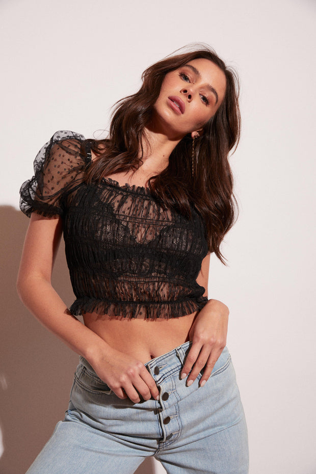 This sheer, short sleeve, black, polka-dotted top is there for your next night out. Dress this one up with one of our bralettes and turn heads everywhere you go.