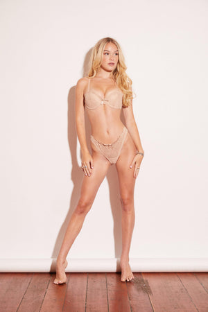 a soft, lustrous, effortlessly sexy, lace bra and panty set. Nude padded bra complete with underwire cups, hook-and-eye closures, and adjustable straps. Set with thong panty.