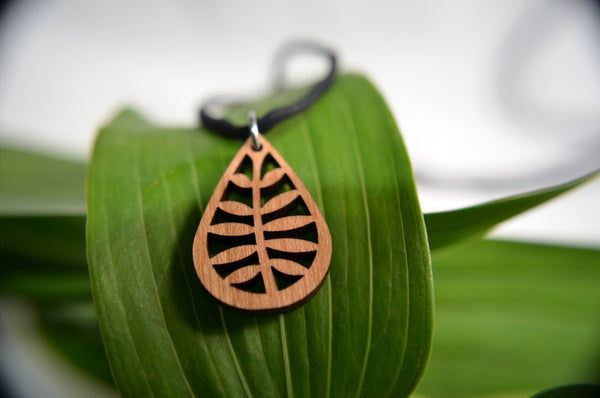 Jewelry: Leafy Pendant in cherry on leather cord.