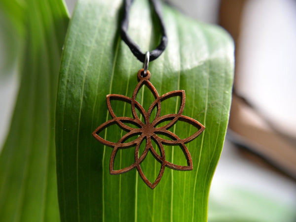 Jewelry: Lotus Flower Pendant in wood on leather cord.