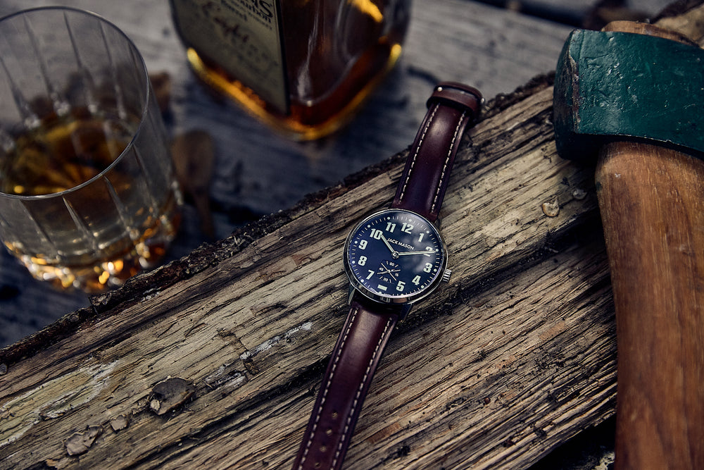 The navy blue men's field watch with brown leather watch straps