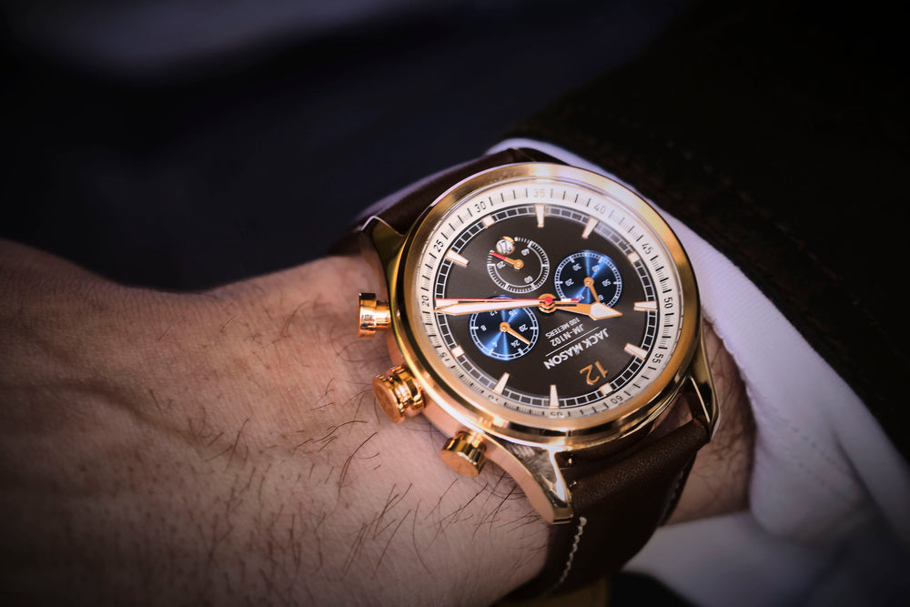 a business man wearing the men's nautical chronograph watch