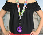 Load image into Gallery viewer, Girl using Figment Magic Band Buddy on a pin trading lanyard