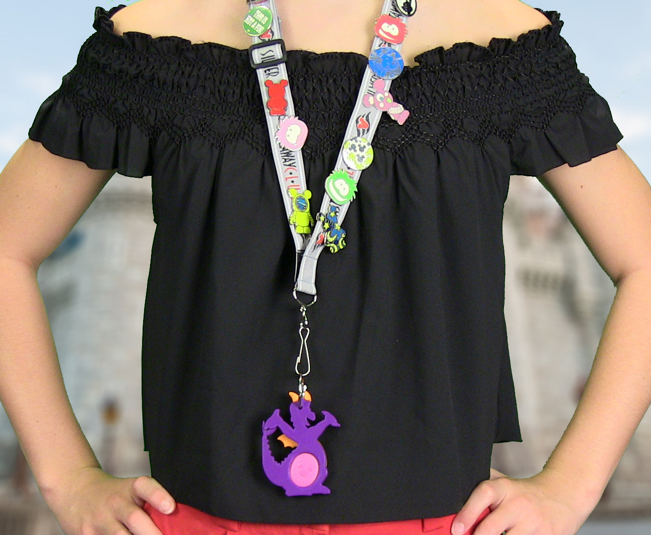 Girl using Figment Magic Band Buddy on a pin trading lanyard