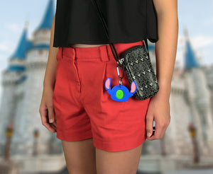 Girl using Stitch Magic Band Buddy with a carabiner clipped to a pouch / purse