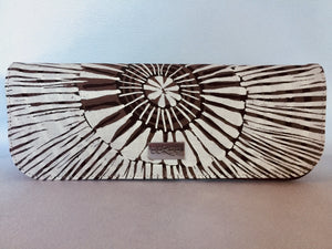 Ebony clutch featuring Fog Dreaming by Aboriginal artist Marita Sambono, Merrepen Arts