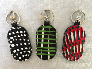 Key Fobs in various silk screen textiles from northern Australian Aboriginal artists