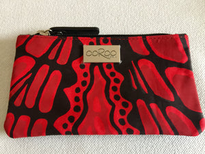Lily purse featuring Crocodile by Aboriginal artist Aaron McTaggart, Merrepen Arts