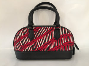 Polo Handbag in black leather featuring Fish Trap by artist Kieren (Karritpul) McTaggart, Merrepen Arts (Sample Stock)