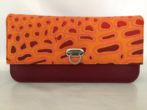 Georgia Clutch in red leather featuring Crocodile Skin by artist Aaron McTaggart, Merrepen Arts