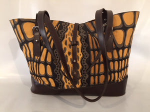 Remi Tote in brown leather featuring Crocodile Skin by artist Aaron McTaggart, Merrepen Arts