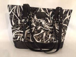 Remi Tote in black leather featuring Mimih Spirits by artist Gabriel Maralngurra, Injalak Arts
