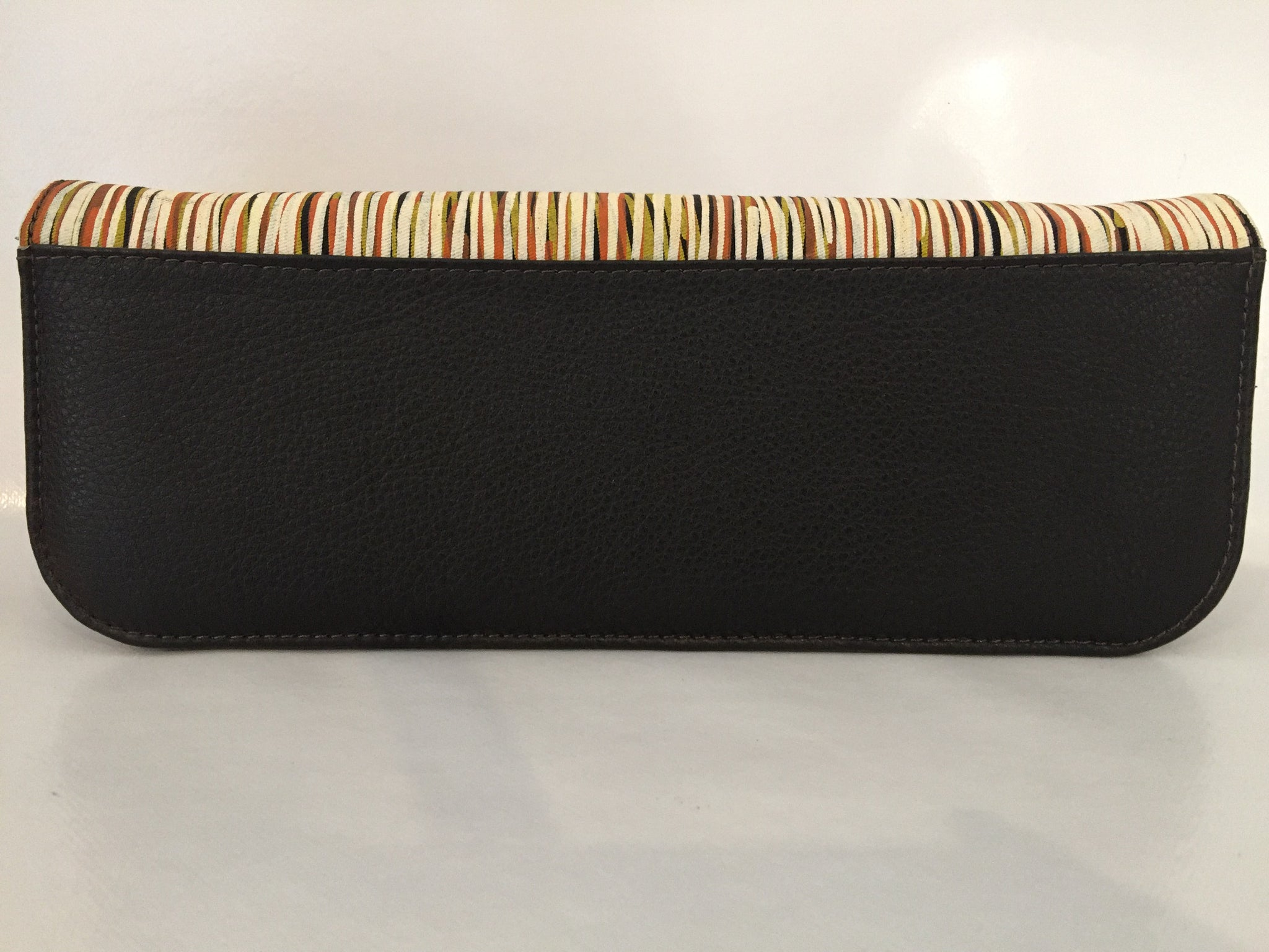 Ebony Clutch in brown leather featuring Yerrgi by artist Kieren (Karritpul) McTaggart, Merrepen Arts
