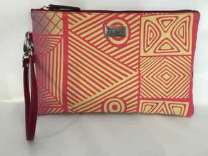 Zara Purse/Clutch in red leather featuring Pandanus by artist Osmond Kantilla, Tiwi Designs (Sample Stock)