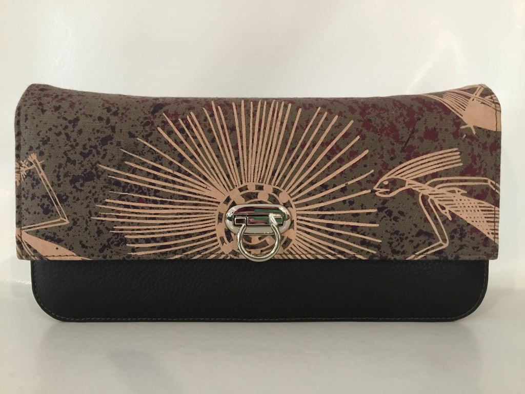 Georgia Clutch in brown leather featuring Mimih Dancers by artists Priscilla Badari, Katra Nganjmirra and Sylvia Badari, Injalak Arts