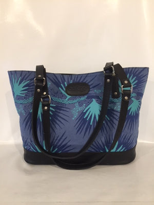 Remi Tote in black leather featuring Merrepen by artist Gracie Kumbi, Merrepen Arts