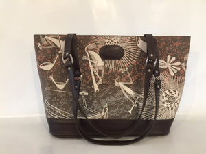 Remi Tote in brown leather featuring Mimih Dancers by artists Priscilla Badari, Katra Nganjmirra and Silvia Badari, Injalak Arts