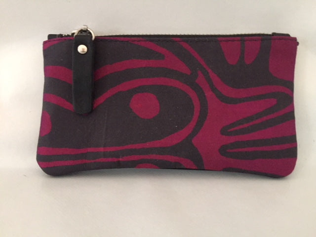 Lily Purse in black leather featuring Burial Ground by artist Jock Puautjimi, Tiwi Designs (Sample Stock)