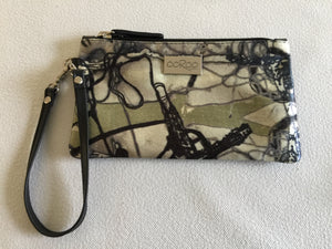 Ella purse featuring Electric Collage by artist Anna Reynolds