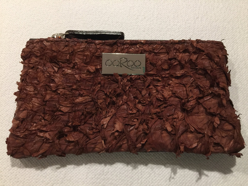 Lilly Purse in brown leather featuring chestnut ruffled barramundi leather