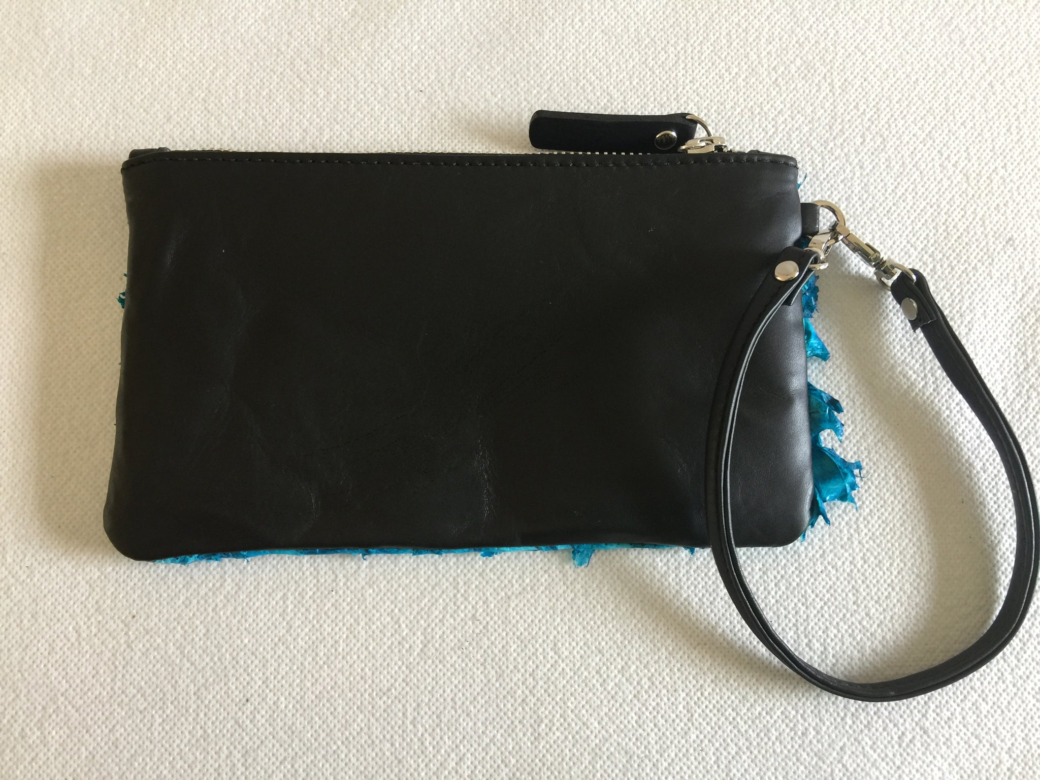 Ella purse in black leather with San Andre's blue ruffled barramundi leather
