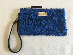 Ella purse featuring blue ruffled barramundi leather