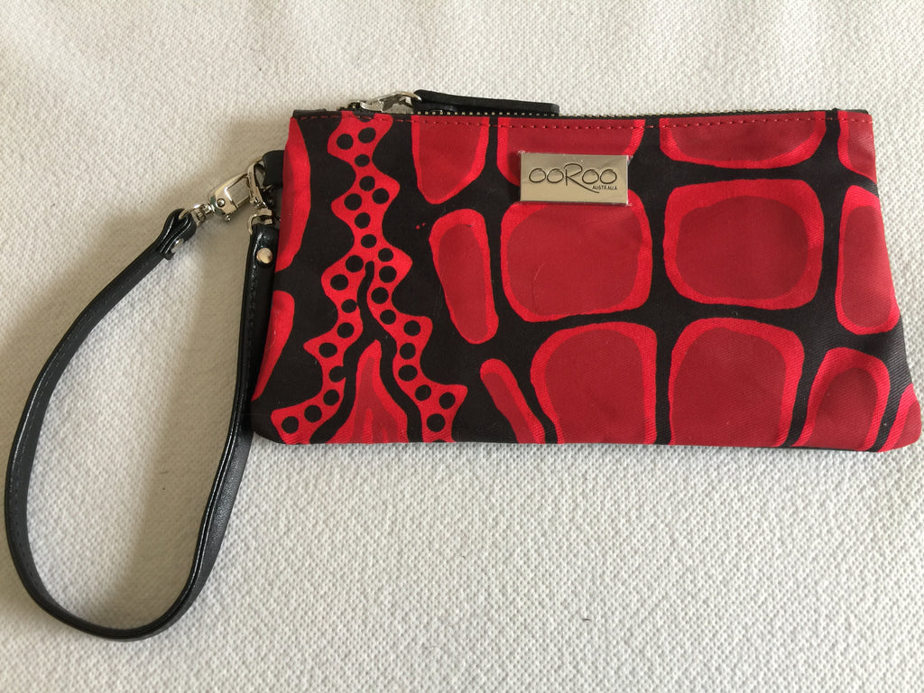 Ella purse featuring Crocodile by Aboriginal artist Aaron McTaggart, Merrepen Arts