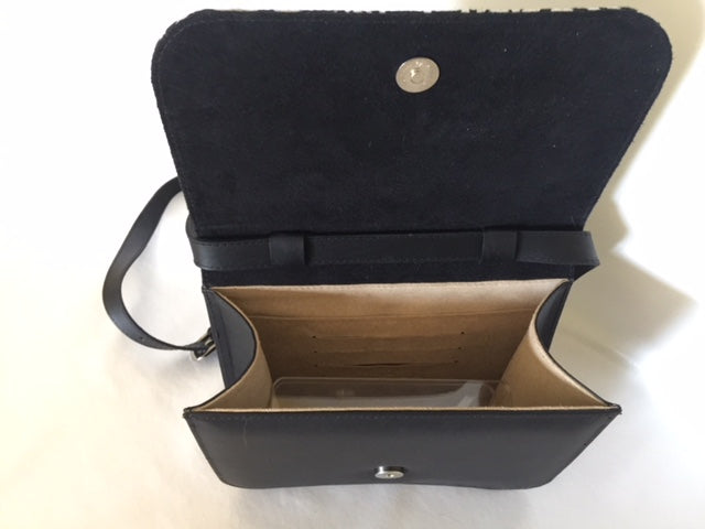Meg cross body Handbag/ small Clutch in black leather featuring Stone Axe by artist Danny Mankara, Tiwi Designs (Sample Stock)