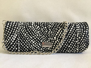 Ebony clutch featuring Winga by Aboriginal artist Marie Josette, Tiwi Designs